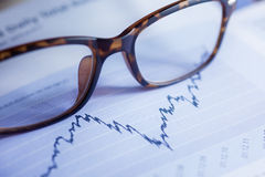 Glasses are laying on ashare index Royalty Free Stock Photography