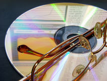 Glasses laying on the CD Royalty Free Stock Photography