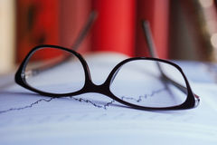 Glasses are laying on a share index Stock Images