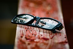 Glasses left out in rain Royalty Free Stock Photography