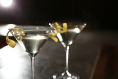 Glasses of lemon drop martini cocktail in bar, closeup. Space for text stock image