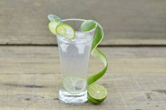 Glasses of lemon soda with ice on rustic wooden background royalty free stock images