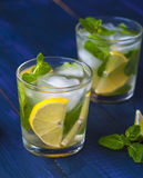 Glasses of lemonade with lemon, lime and mint Royalty Free Stock Images