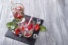 Glasses of lemonade with strawberries royalty free stock images