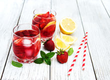 Glasses of lemonade with strawberries Stock Photo