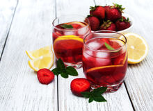 Glasses of lemonade with strawberries Stock Images