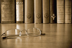 Glasses in library Royalty Free Stock Photography