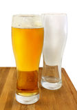 Glasses of light beer and empty glass Royalty Free Stock Photo