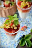 Glasses with a light creamy dessert and berries Royalty Free Stock Images