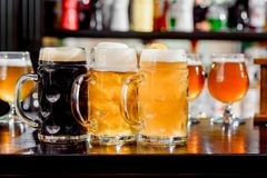 Glasses of light and dark beer on a bar counter. pub. Liter glass Stock Photography