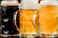Glasses of light and dark beer on a bar counter. pub. Liter glass Stock Image