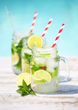 Glasses of lime lemonade near pool Royalty Free Stock Photos