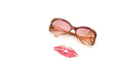 Glasses and lips forming woman face Royalty Free Stock Image
