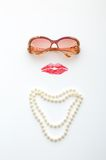 Glasses, lips and necklace forming woman face Stock Images