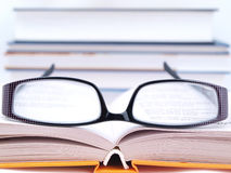 Glasses lying on the book Royalty Free Stock Image