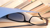 Glasses lying on the book Royalty Free Stock Photography