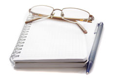 Glasses lying on a notebook Stock Photo