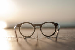 Glasses lying on a wooden table front view sundawn Royalty Free Stock Photography