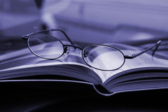 Glasses and the Magazine Stock Images