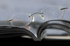 Glasses on the magazine Stock Photo