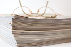 Glasses and Magazines Royalty Free Stock Image