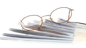 Glasses magazines isolated on white Royalty Free Stock Images
