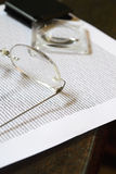 Glasses and a Magnifying Glass royalty free stock images