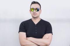 Glasses man. Man wearing sunglasses in studio Stock Photo