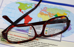 Glasses on map. Of geographic book stock illustration