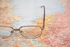 Glasses on map stock photography