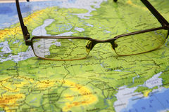Glasses on a map of europe. Photo of glasses on a map of europe. Focus on baltic countries. May be used as illustration for traveling theme Stock Photography