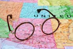 Glasses on a map of USA - Arizona. Photo of glasses on a map of USA. Focus on Arizona. May be used as illustration for traveling theme stock photography