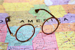Glasses on a map of USA - Arkansas Stock Photos