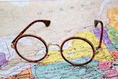 Glasses on a map of USA - New York Stock Photography