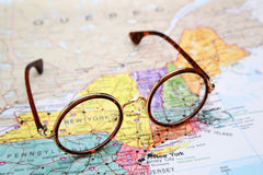 Glasses on a map of USA - New York Royalty Free Stock Images