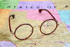 Glasses on a map of USA - Texas Royalty Free Stock Photography