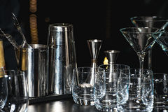 Glasses for a margarita, martini, grog and liqueur on a bar at restaurant, against the bar bar wall background. stock photos