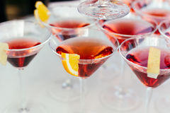 Glasses with Martini garnished a slice of orange. royalty free stock photo
