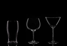Glasses. A Martini Glass, a Wine Glass and a Pint Glass on a Black Background stock photo