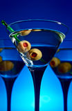 Glasses with martini and green olives Royalty Free Stock Photography