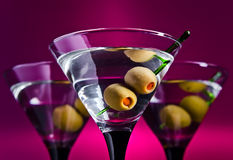 Glasses with martini and green olives Royalty Free Stock Photo