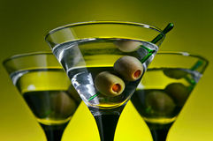 Glasses with martini and green olives Stock Photo