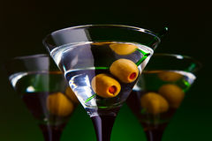 Glasses with martini and green olives Stock Photography