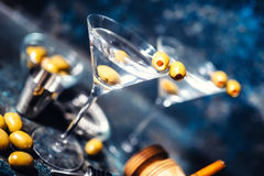 Glasses of martini with olives and vodka. Alcoholic beverages served at bar Royalty Free Stock Image