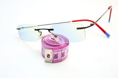 Glasses  and measurements Royalty Free Stock Photo