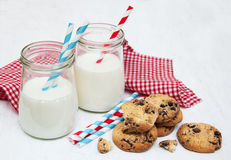 Glasses of milk and cookies. On a old white wooden background Royalty Free Stock Images