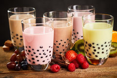 Glasses of milky boba or bubble tea Stock Images