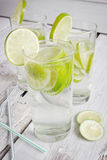Glasses of mineral water and a slice of lime Royalty Free Stock Photography
