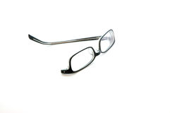 Glasses with missing arm. Glasses with a single arm isolated on white Royalty Free Stock Photo