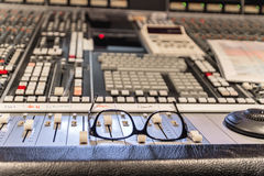 Glasses on the mixer at recording studio Royalty Free Stock Photo